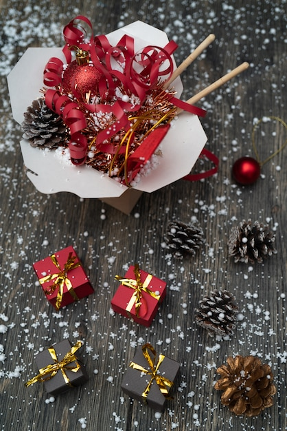 Christmas gifts in wok paper packaging boxes. for asian fast foods. Premium Photo