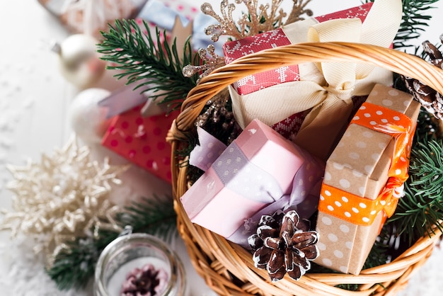 Christmas gifts on wooden background. Premium Photo