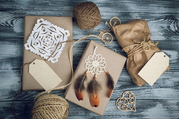 Christmas gifts on wooden Premium Photo