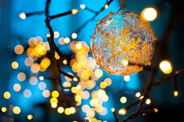 Christmas gold lights christmas garland blue background Premium Photo