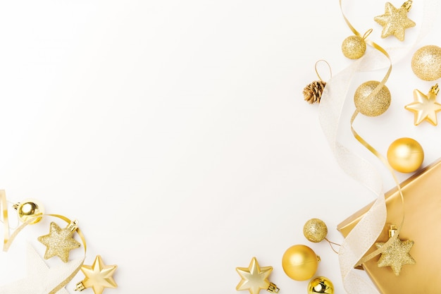 Christmas golden decoration on white Free Photo