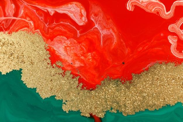クリスマスの緑、赤、金のクリエイティブアブストラクトペイントの背景。 Premium写真