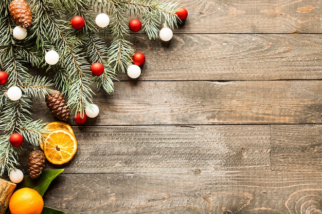 Christmas holiday surface with ornaments on rustic wooden surface. Premium Photo