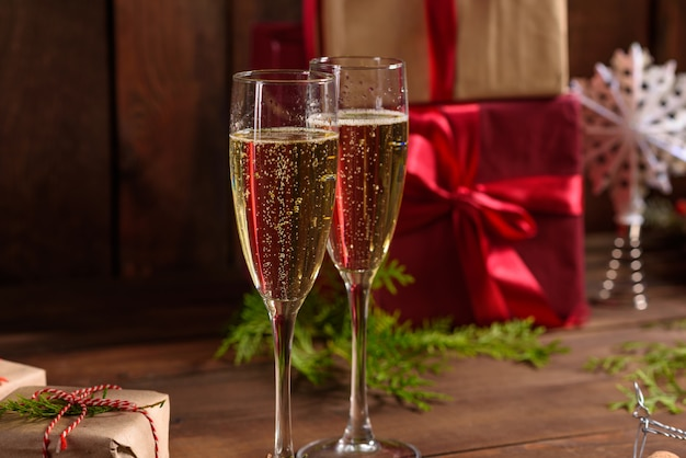 Christmas holiday table with glasses and a bottle of wine Premium Photo