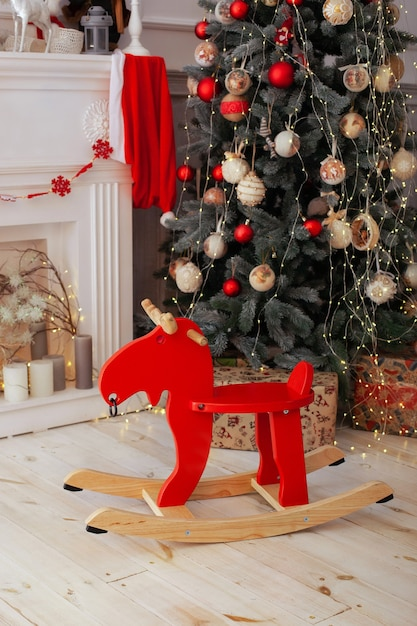Christmas interior room with wooden elk rocking chair Premium Photo