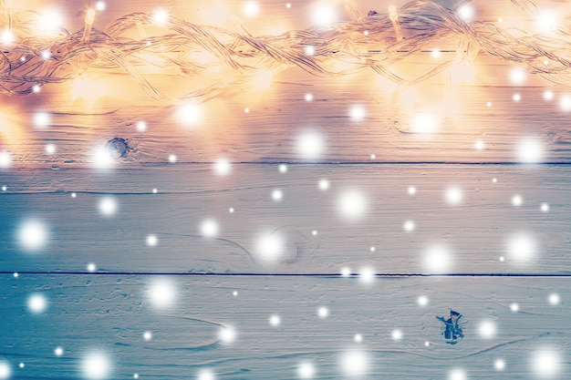 Christmas Light And Decoration With Snow On White Wood Background Copy Space Premium Photo