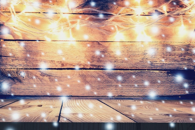 Christmas Light On Wooden Background And Table Vintage Decoration With Lights