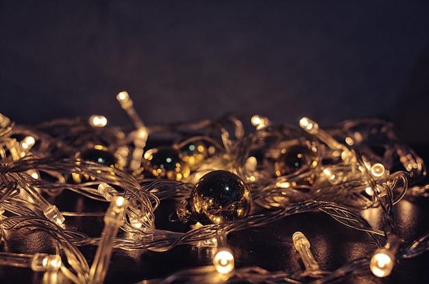 Christmas lights background. xmas glowing garland Premium Photo