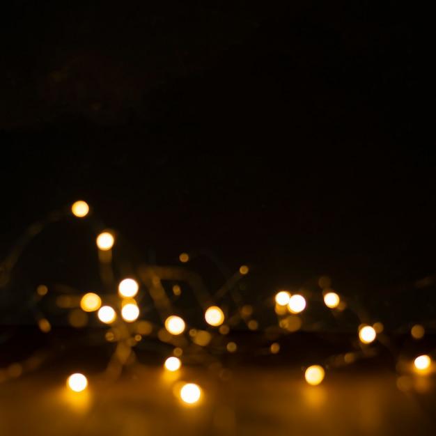 Christmas lights blurred on black Premium Photo
