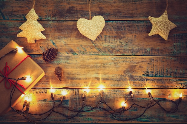 Christmas Lights Bulb With Decoration On Wood Table Merry Xmas Background