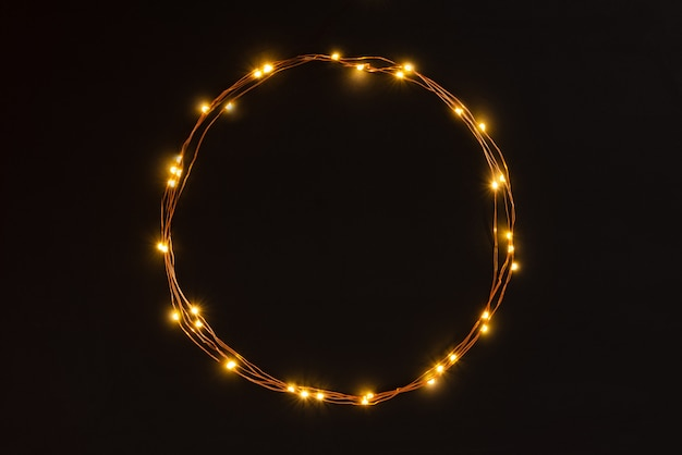 Christmas lights garland border over black background. Premium Photo