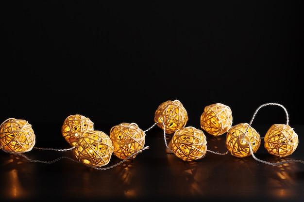 Christmas lights garland on dark Premium Photo