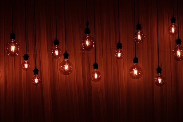 Christmas lights isolated. garlands of lamps on wood Premium Photo