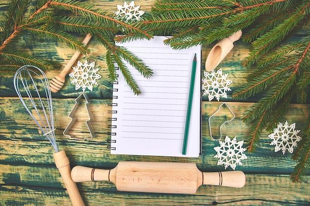 Christmas menu plan or recipe on green rustic wooden Premium Photo