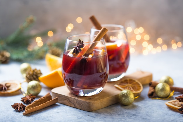 Christmas mulled wine delicious holiday like parties with orange cinnamon star anise spices. traditional hot drink or beverage, festive cocktail at x-mas or new year Premium Photo