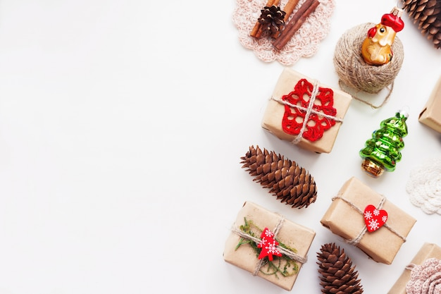 Christmas and new year background with handmade presents wrapped in craft paper and decorations. Premium Photo
