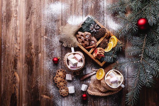 Christmas and new year decor. two cups with hot chocolate, cinnamon cookies Free Photo