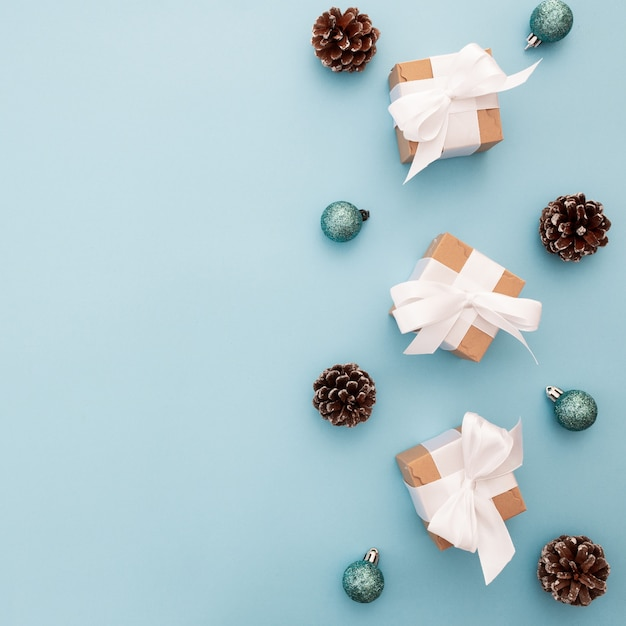 Christmas ornaments on a blue background with copyspace Free Photo