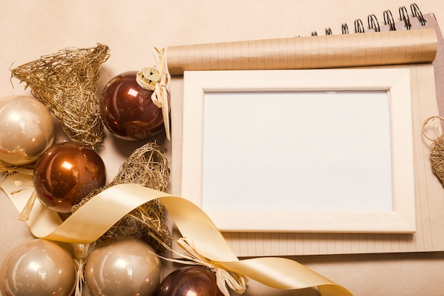 Christmas ornaments and decoration on blank photo frame Premium Photo