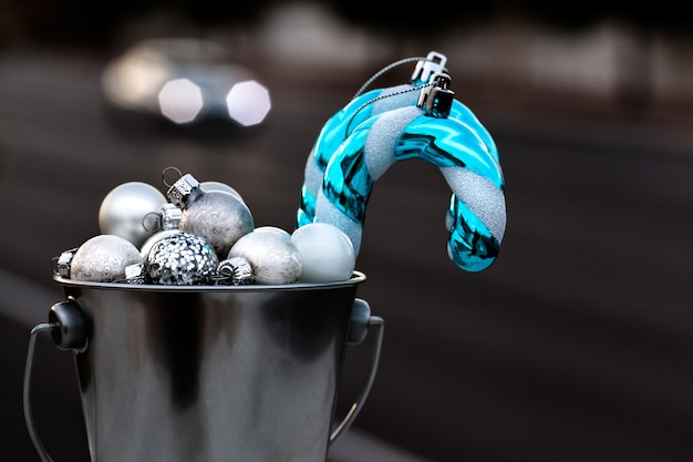 Christmas ornamnets collected in silver bucket for decorating christmas tree Premium Photo