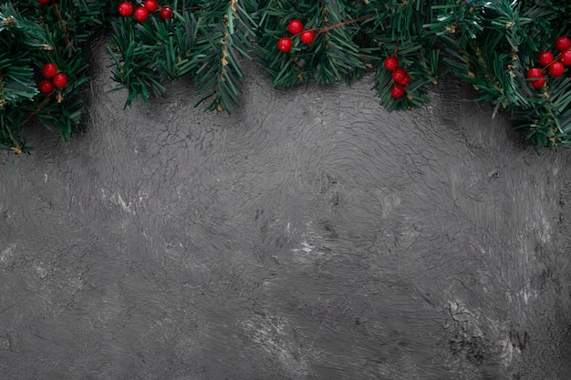 Christmas pine leaves with mistleote Free Photo