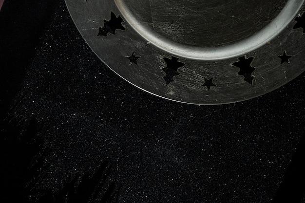 Christmas plate on black table Free Photo