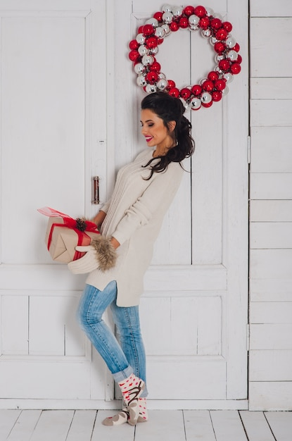56b2412e3 Christmas portrait of a girl with present in winter clothes. Photo ...