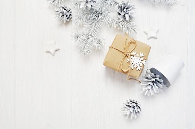 Christmas present with pine cones Premium Photo