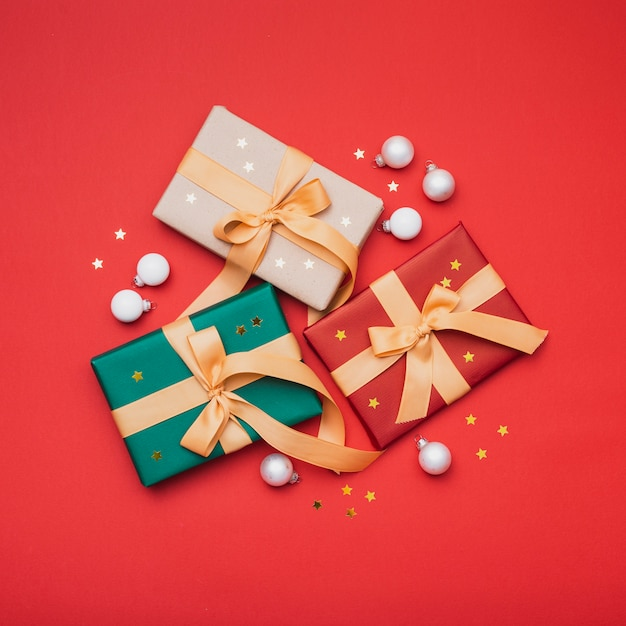 Christmas presents with golden stars and globes Free Photo