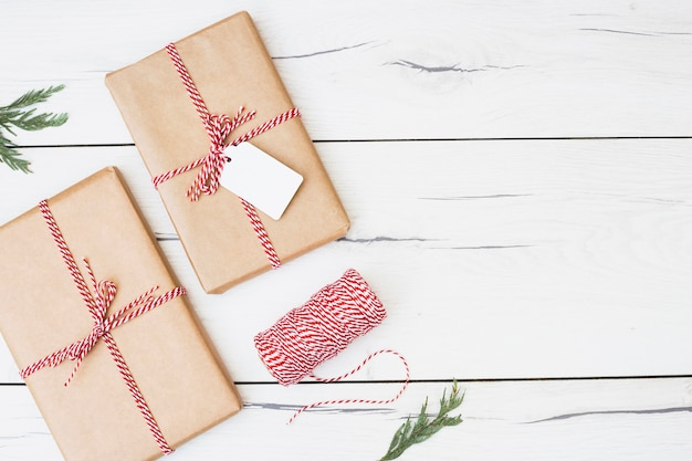 Christmas presents wrapped with striped ribbon Free Photo