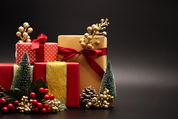 christmas season background and happy new year gift box on black background premium photo