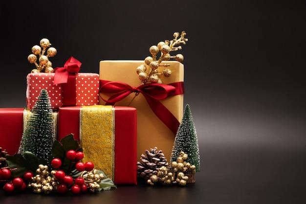 christmas season background and happy new year gift box on black background premium photo