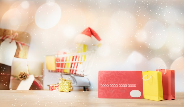 Christmas shopping online concept.Credit card and shopping bag. Premium Photo