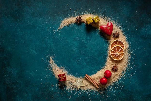 Christmas spices and decor, brown sugar poured  half moon shape Premium Photo