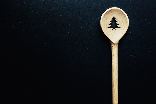 Christmas spoon on dark table Free Photo