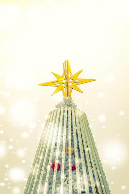 Christmas star on top of tree Free Photo