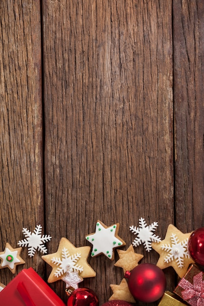 Christmas stars on a wooden table Free Photo