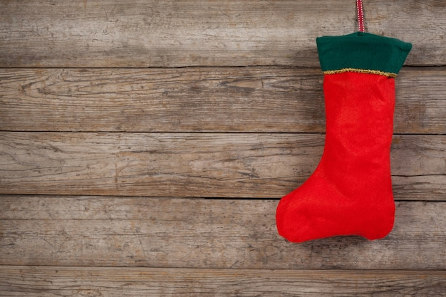 Christmas stocking hanging from a rope Free Photo