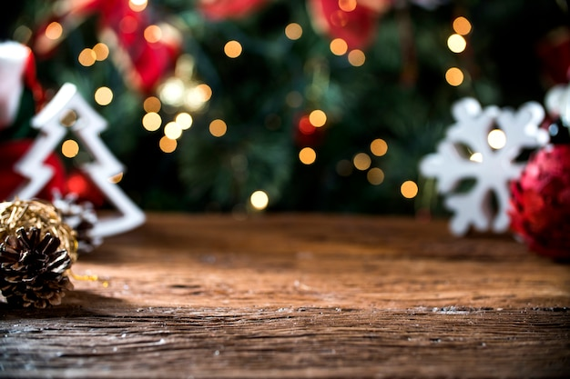 Christmas table blurred lights background, wood desk in focus, xmas wooden plank, blur home room Premium Photo