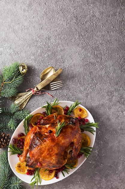 Christmas table with baked turkey or chicken, copy space for text. Premium Photo