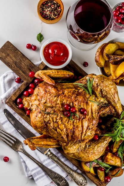 Christmas, thanksgiving food, baked roasted chicken with cranberry and herbs Premium Photo