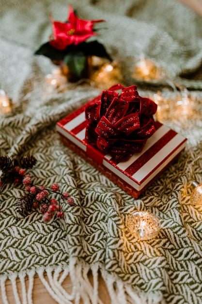 Christmas themed gift box with a poinsettia Free Photo