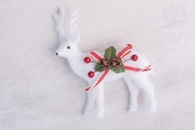 Christmas toy deer on white surface Free Photo