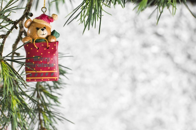 Christmas toy hanging on fir tree Free Photo