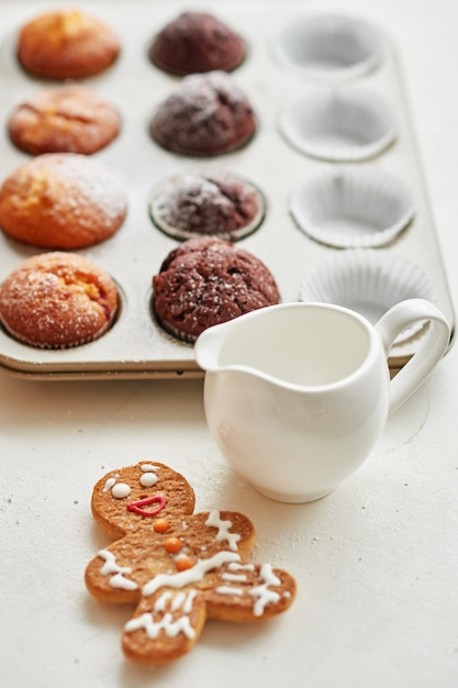 Christmas treats on the table: cupcake, naked cake, cookies and coffee with honey Premium Photo