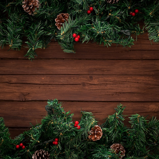 Christmas tree branches on wooden background Free Photo