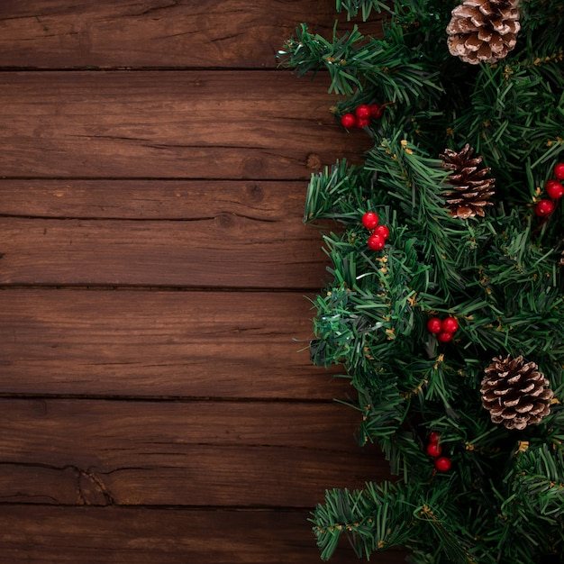 Christmas Tree Branches On A Wooden Background Photo Free