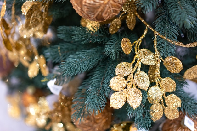 Christmas tree close up with gold decorations Premium Photo