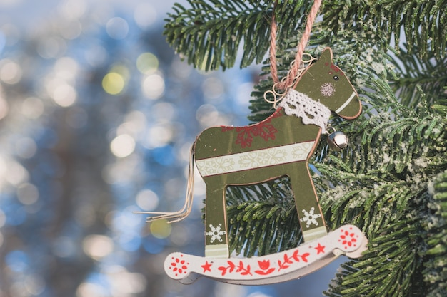 Christmas tree decoration with horse shape close up Free Photo