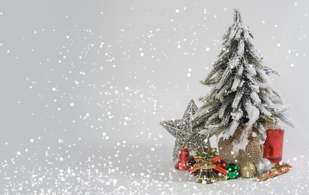 Christmas tree and decorations on white background Premium Photo